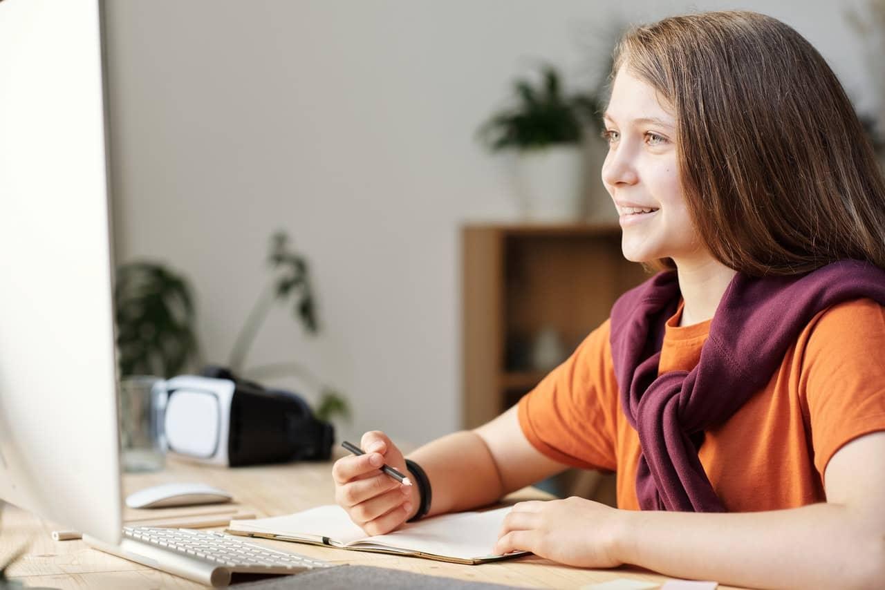 Girl smiling in virtual school